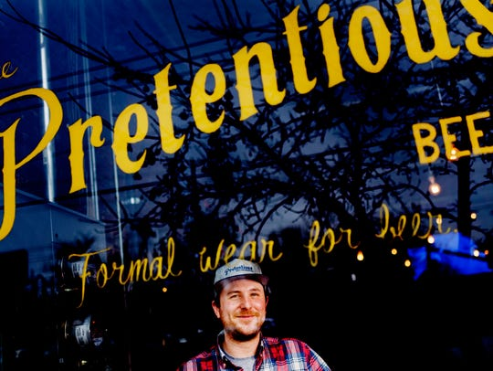 Owner Matthew Cummings poses for a portrait at Pretentious Beer Co. in the Old City on Feb. 6.