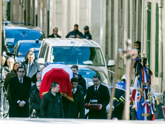 The funeral convoy of Col. Arnaud Beltrame arrives outside the Carcassonne cathedral Thursday, March 29, 2018 in Carcassonne, southern France.
