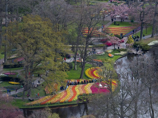 Tourists view tulips, daffodils, hyacinths and more