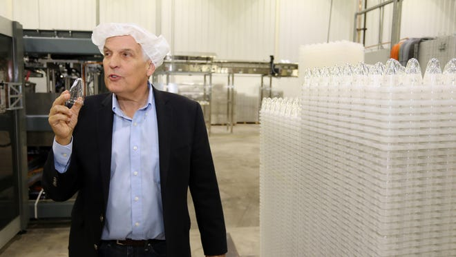 Invento President William Brandell talks about the difficulty of making cans out of plastic at the Invento plant Tuesday April 5, 2016 in Sheboygan.