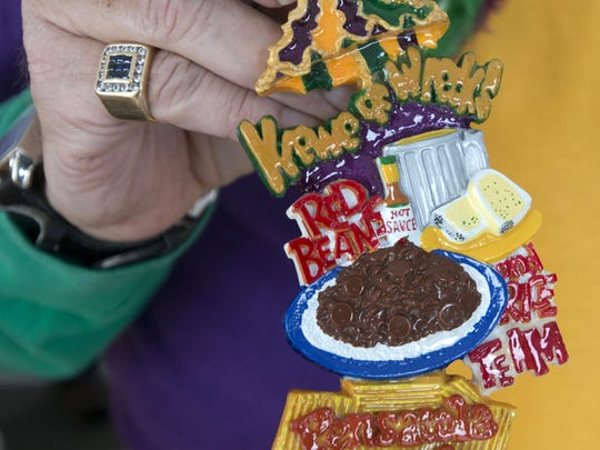 The Krewe of Wrecks made this necklace to commemorate the krewe's annual Red Beans and Rice luncheon.