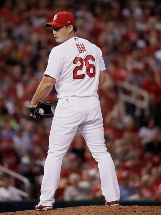 St. Louis Cardinals relief pitcher Seung-Hwan Oh checks a runner at first during the seventh inning of a baseball game against the Arizona Diamondbacks, Friday, July 28, 2017, in St. Louis. (AP Photo/Jeff Roberson)