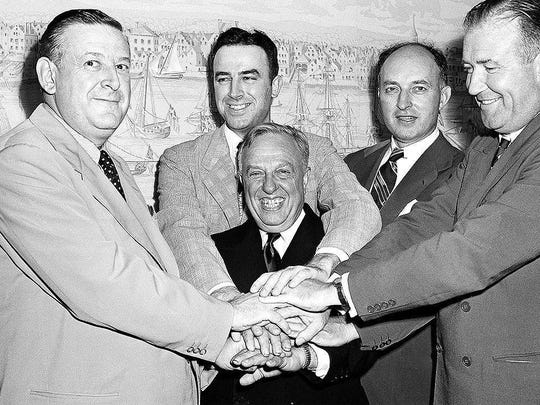 Leo Ferris, second from left in the back, appears in this well-known photo from Aug. 3, 1949 in New York after the National Basketball League and Basketball Association of America agreed to a merger, forming the National Basketball Association. NBA President Maurice Podoloff is in the center. From left around Ferris are Ike Duffey, Ned Irish and Walter Brown.