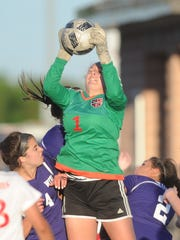 Mineral Wells goalie Reagan Carter (1) makes a stop on a Wylie corner kick late in the second half. Mineral Wells won the Region I-4A quarterfinal playoff game 1-0 Monday, April 3, 2017 at Ram Stadium in Mineral Wells.