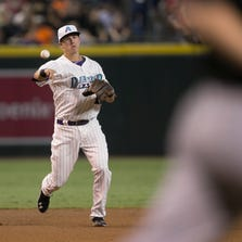 The Diamondbacks' Jake Lamb throws out the Rockies' Tyler Maztek at Chase Field on Aug. 30, 2014.