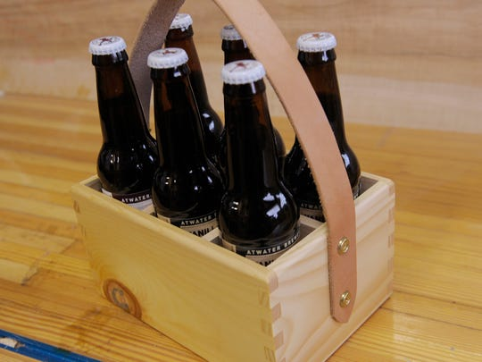 Hunt & Noyer Woodworks products include custom beer carriers. D:hive's event will connect shoppers and business owners.