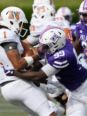 Furman's Chris Washington (99) sacks Mercer quarterback Kaelan Riley (1).