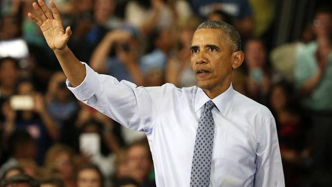 President Barack Obama waves to the audience after speaking at Concord Community High School in Elkhart, Ind., addressing the city's economic success since 2009, Wednesday, June 1, 2016. Obama first visited Elkhart in January of 2009, his first trip as president.