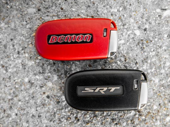 Two key fobs are given to the owners of the 2018 Dodge Challenger SRT Demon. The black fob limits engine output to 500 horsepower, while the red one allows the full output of over 800 horsepower.