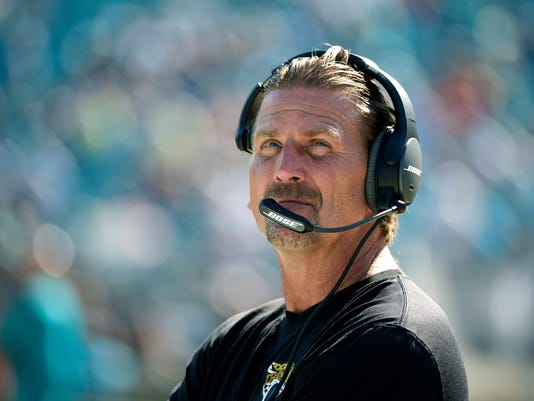 FILE - In this Sept. 20, 2015, file photo, Jacksonville Jaguars offensive coordinator Greg Olson watches from the sideline before an NFL football game against the Miami Dolphins in Jacksonville, Fla. The Jaguars fired Olson on Saturday, Oct. 29, 2016, parting ways with him two days after an embarrassing loss at Tennessee. (AP Photo/Phelan M. Ebenhack, File)