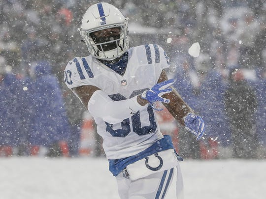 Indianapolis Colts wide receiver Chester Rogers (80) throws a snowball at fellow wide receiver T.Y. Hilton (13) after a touchdown by tight end Jack Doyle (84) against the Buffalo Bills in the fourth quarter at New Era Field in Orchard Park, N.Y., on Sunday, Dec. 10, 2017.