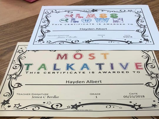 Hayden Albert, a first grade student at Evangeline Elementary, received these certificates from his teacher on Monday.
