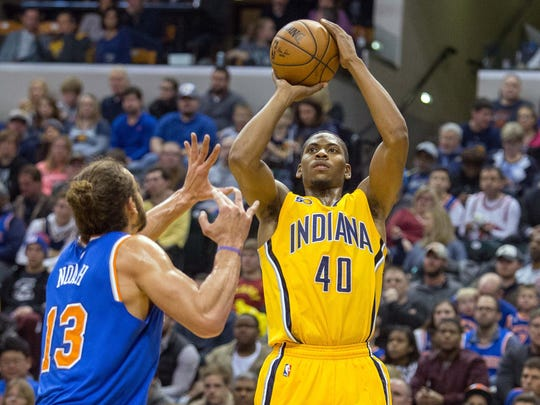 Glenn Robinson III shoots over Knicks center Joakim Noah on Jan. 7, 2017 in Indianapolis.