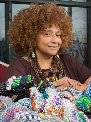 The artist Joyce J. Scott with her work, entitled 'Harriet's Quilt (2017)', at Motor House in Baltimore, Maryland.