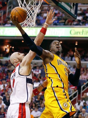 Indiana Pacers center Roy Hibbert (55) shoots under pressure form Washington Wizards center Marcin Gortat of Poland during the second half of Game 3 of an Eastern Conference semifinal NBA basketball playoff game in Washington, Friday, May 9, 2014.