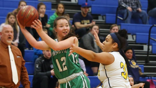 Irvington's Heather Hall (12) looks for an open teammate