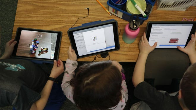 In this March 13 file photo, first-graders practice using the app Canvas, which they'll use to submit their class assignments and maintain contact with teachers at Avery Elementary School in Hilliard.