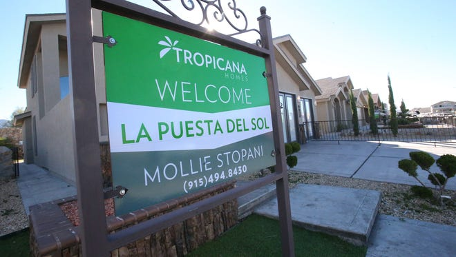A row of  model homes sit behind a Tropicana Homes sign at Westfield and La Puesta drives in West El Paso.