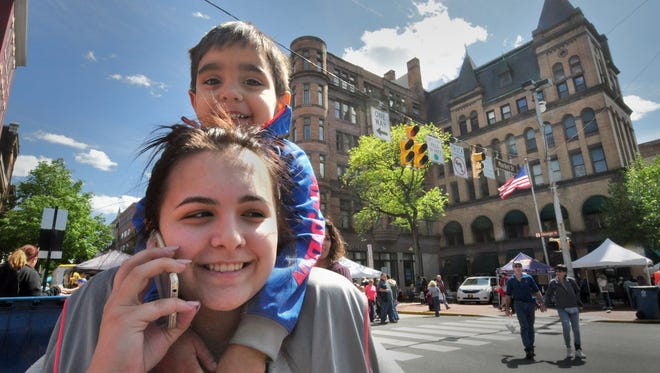Giani Cimmino-Toomey, 3, got a ride from his mom Theresa Cimmino during the 41st annual Olde York Street Fair that attracted near-record crowds Sunday, May 8, 2016. Bil Bowden photo