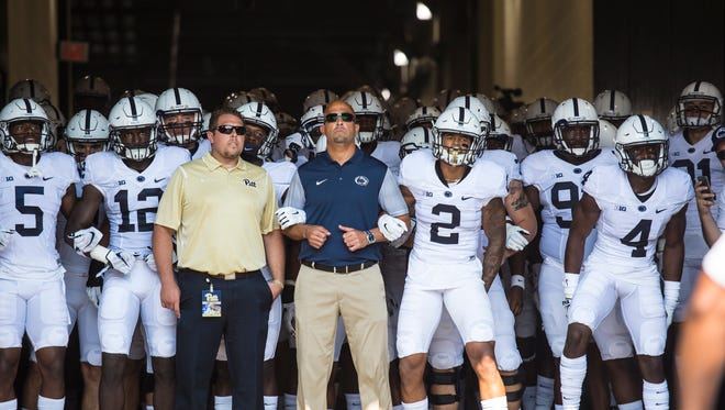 Penn State Nittany Lions head coach James Franklin gets read to lead the team onto the field at  Heinz Field in Pittsburgh as Penn State fell to Pitt 42-39 on Saturday, Sept. 10, 2016.