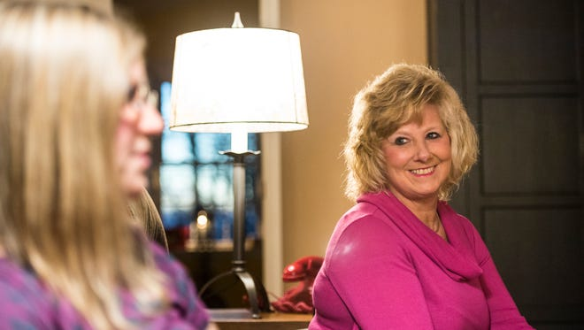 Phyllis Weiant looks at her daughter, Amanda Musser, as she talks about her battle with cancer.