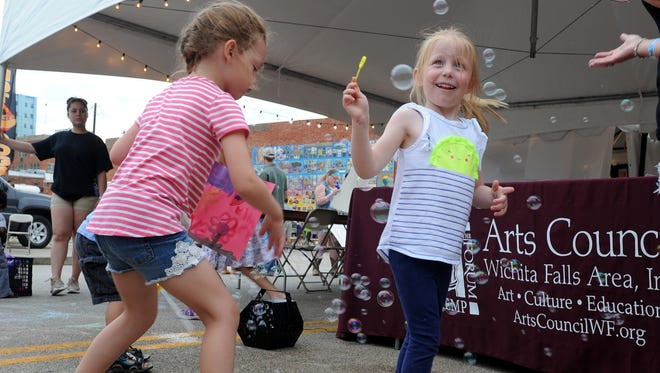In this file photo, kids catch bubbles at the Art and Soul Festival in June 2017, at the Wichita Falls Downtown Farmers Market. Wichita Falls was ranked seventh out of 535 U.S. cities for dual-worker families.