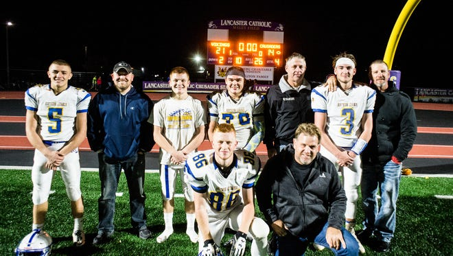 Northern Lebanon's Stevie Herb, his father Stephen Herb, Ethan Herb, Ryan Walker, Scott Lutz, Michigan Daub and Tony Daub. Front row Caleb Light and John Light as Northern Lebanon held off Lancaster Catholic 21-14 to win the Section 3 title at Lancaster Catholic on Friday, Nov. 3, 2017.