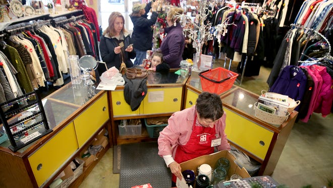 Volunteer Kathy Fitch works at North Kitsap Fishline's Second Season Thrift Store on Tuesday. The store is moving from its cramped Anderson Parkway quarters to a larger space in the Poulsbo Village shopping center.