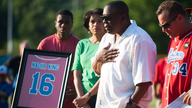 """Nadiir King's jersey number """"16"""" is retired in a special ceremony held in Washington Twp, June 16, 2014.  King's father, Stanley, speaks to the crowd as his wife Sharon, son, Norris and baseball advisory board member John Striano (at right) look on."""