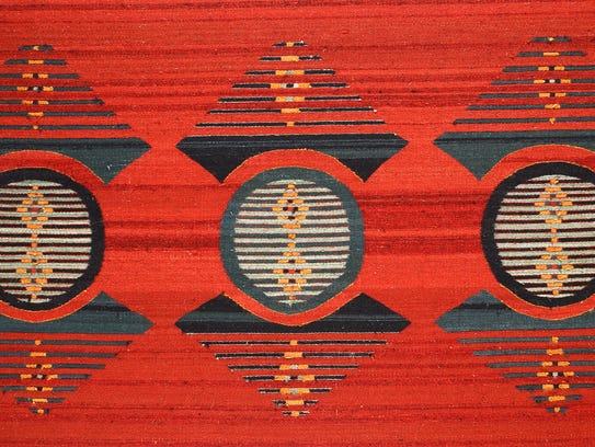"""Escudo Triple Red,"" fiber tapestry by Wence Martinez"