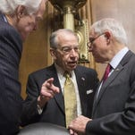Senate Judiciary Committee Chairman Sen. Chuck Grassley, R-Iowa, center, Sen. John Cornyn, R-Texas, the majority whip, left, and Sen. Jeff Sessions, R-Ala., right, confer Tuesday before a hearing on Capitol Hill in Washington.