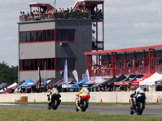 Motorcyclists compete during the AMA Pro Road Racing