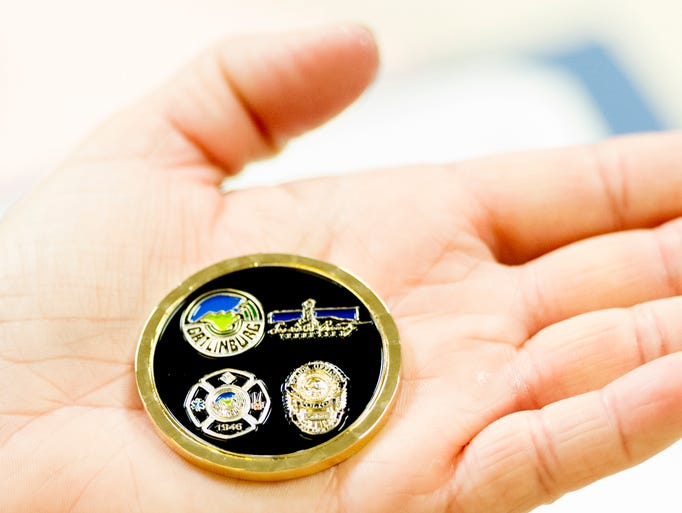 AMR EMS Heather Allen holds her coin during a ceremony