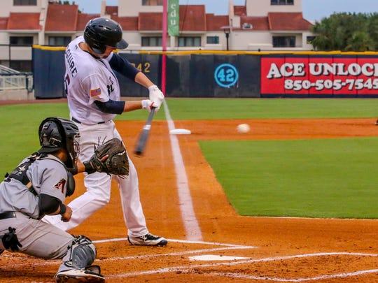 Blue Wahoos pitcher Deck McGuire bats against the Jackson