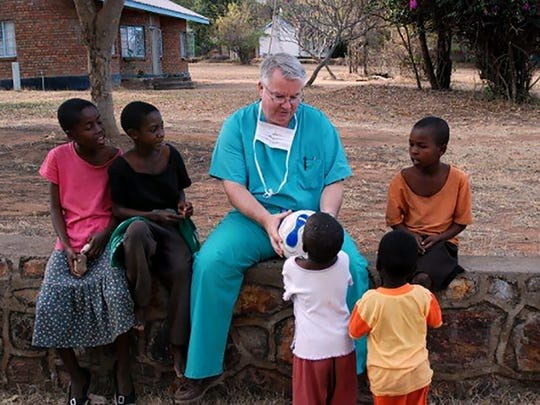 Kyle Sheets speaks with children during a mission trip to Zimbabwe earlier this year. Sheets will be named Humanitarian of the Year during the annual conference of the American Academy of Family Physicians in San Antonio this week. He is being honored for his work establishing Physicians Aiding Physicians Abroad (PAPA Missions) in 2003.