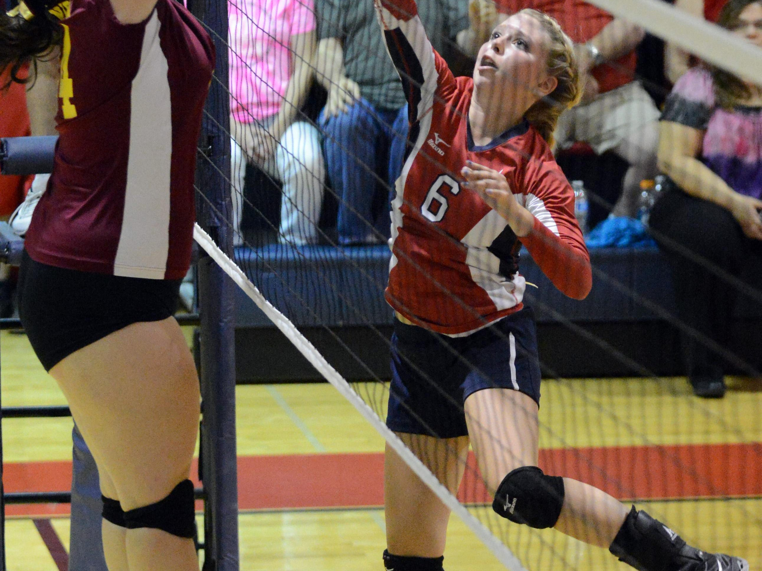 Fairfield Christian's Sydney Tucker tries to tip the ball over the net as Berne Union's Lauren Zody blocks Thursday at Fairfield Christian Academy in Lancaster. The Rockets won the match three games to two.
