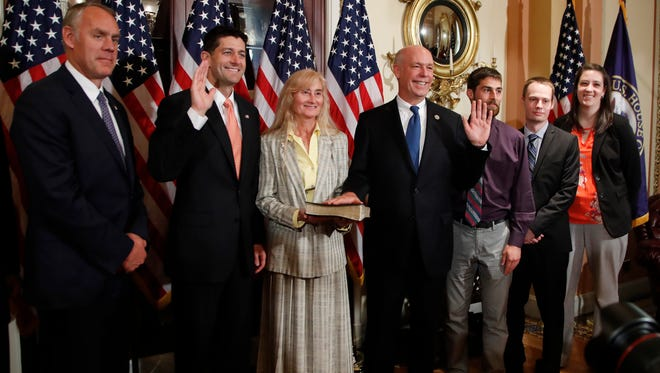 Speaker of the House Paul Ryan, R-Wis., holds a ceremonial swearing-in for Montana Republican Greg Gianforte, joined by his wife Susan and his family, and Interior Secretary Ryan Zinke, left, at the Capitol in Washington, Wednesday, June 21, 2017. Gianforte, 56, won a May 25 special election to serve the remaining 18 months in the House term vacated by now-Interior Secretary Ryan Zinke. (AP Photo/Manuel Balce Ceneta) in Washington, Wednesday, June 21, 2017. (AP Photo/Manuel Balce Ceneta)