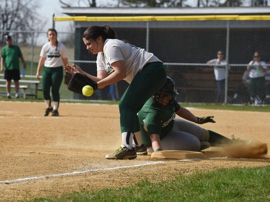 Spackenkill's Liana Lopez slides safely into third base as Webutuck's Victoria Gilleo commits an error during Monday's game.