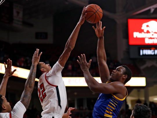 Texas Tech's TJ Holyfield (22) blocks a shot by Cal State Bakersfield's Ronne Readus (0) during the first half of an NCAA college basketball game Sunday, Dec. 29, 2019, in Lubbock, Texas. (AP Photo/Brad Tollefson)