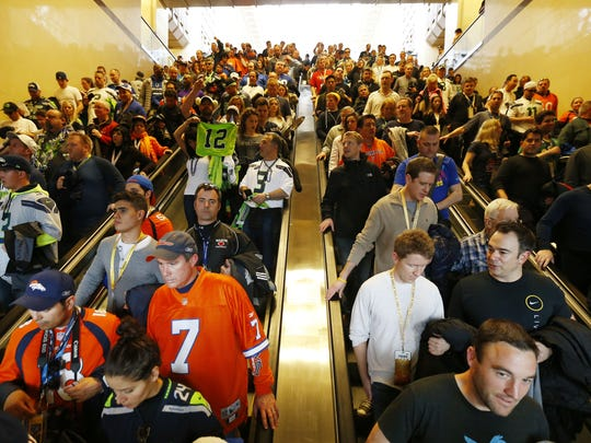 Football fans in Secaucus make their way to trains for Met Life Stadium on Feb. 2 for the Super Bowl. The crowds were far larger than N.J. Transit anticipated.