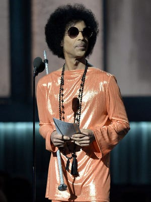 Prince presents an award at the 57th Annual Grammy Awards in Los Angeles.