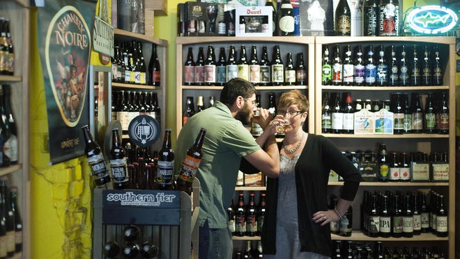 Jason and Julie Atallah have owned Bruisin' Ales, a beer store on Broadway Street, since 2006. The store sells several rare and specialty beers as well as local favorites and has an online store with local pickup options.