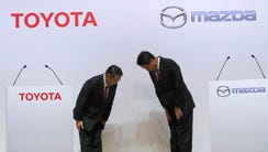 Toyota Motor Corp. President Akio Toyoda, left, and
