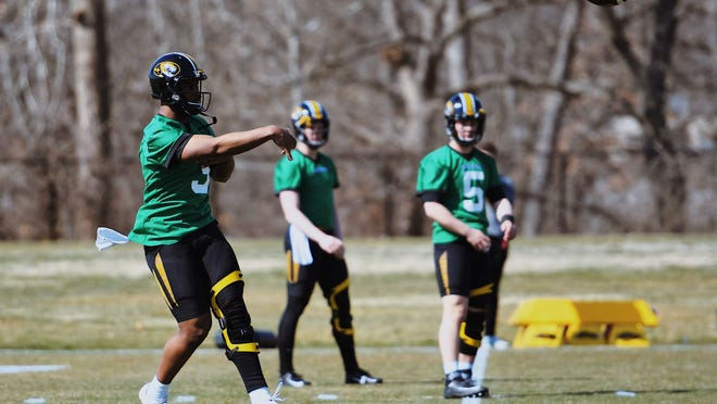 Missouri quarterback Shawn Robinson (3) throws the ball during spring practice March 7 at the Kadlec Practice Fields.