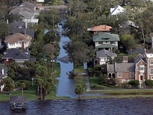 A few streets remain flooded along the St. John's River in Jacksonville, Fla., in the aftermath of Hurricane Irma, Tuesday, Sept. 12, 2017. (AP Photo/John Raoux)