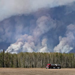 Evacuees from the wildfire in Fort McMurray collect donated necessities at an evacuation center in Lac la Biche, Canada, on May 5, 2016.
