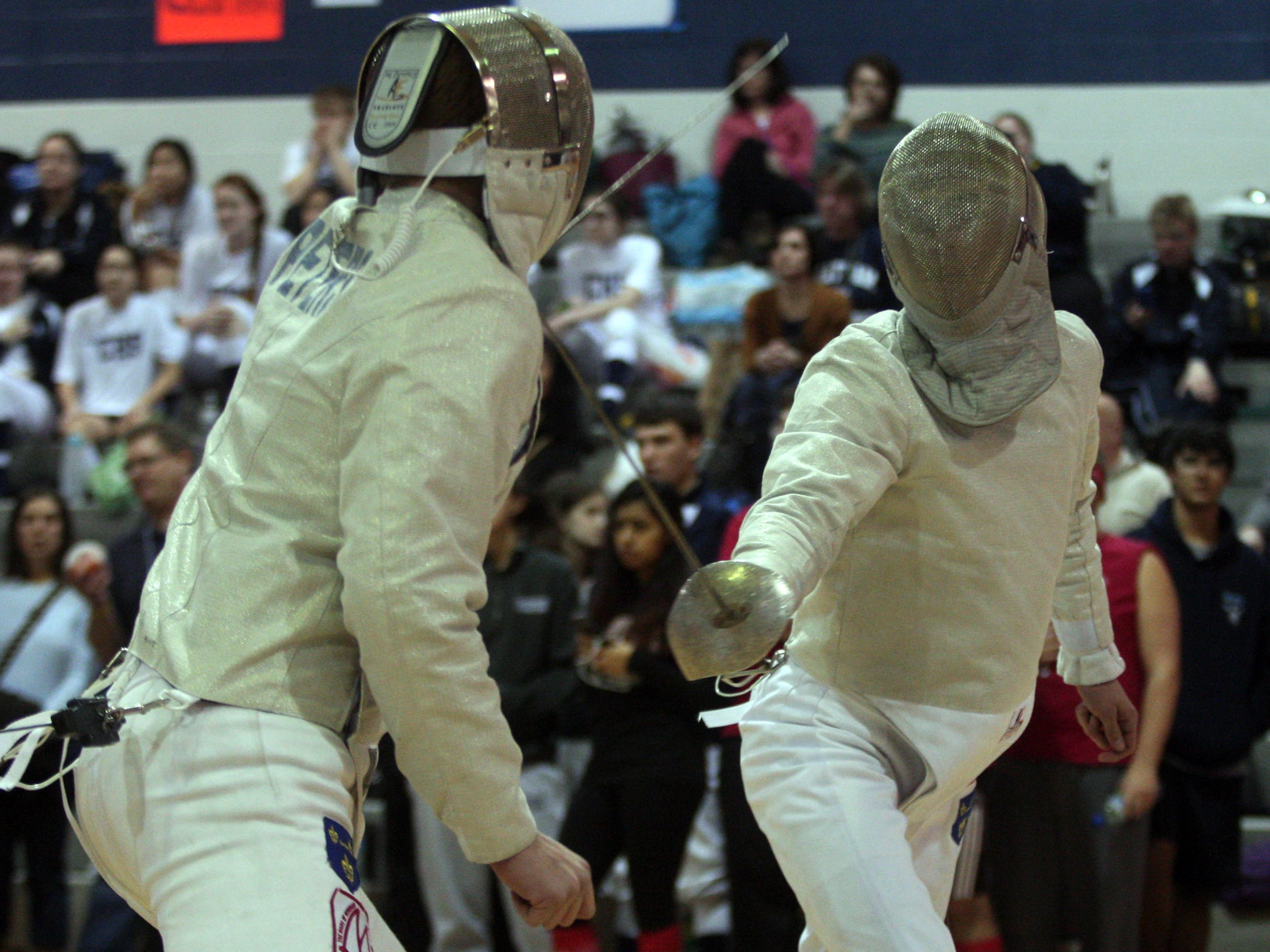 Mendham's Matt Peters (left) and Andrew Creager during the individual sabre finals of the Morris County Fencing Tournament on Jan. 17 at Randolph.