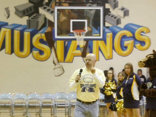 Former Fountain Central athletic director Brian Moore fires up students at a pep rally in 2010 prior to the Mustangs playing Central Catholic in the Class A state championship.