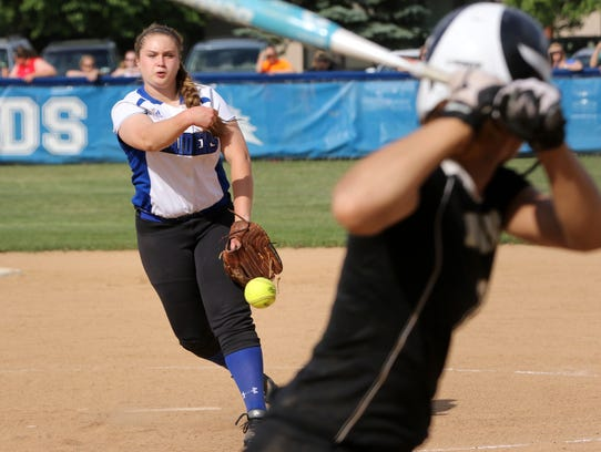 Juliana Rich of Horseheads delivers a pitch tp a Corning