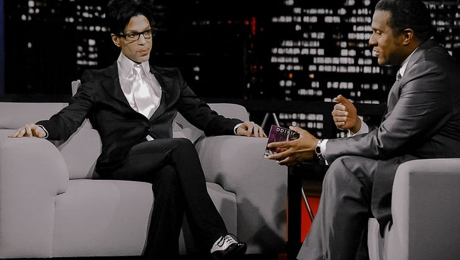 The author, Tavis Smiley, interviews Prince in 2009.